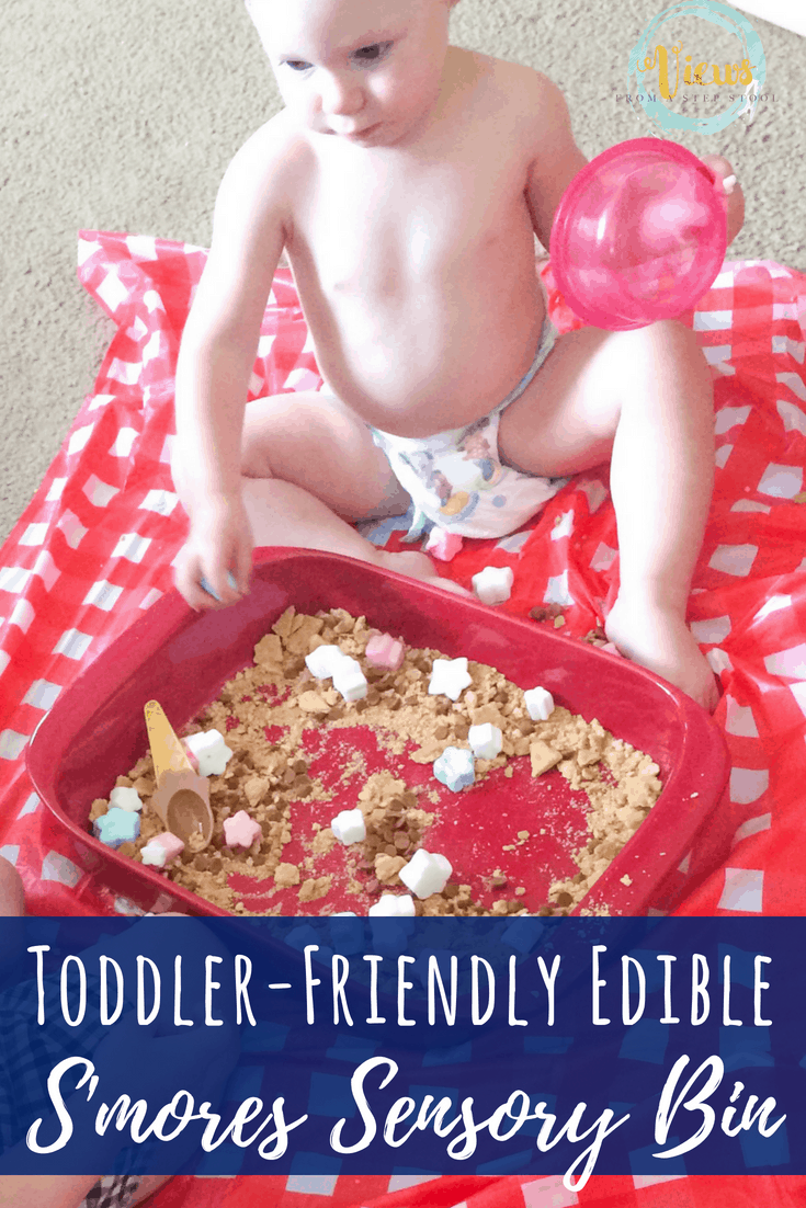 This s'mores sensory bin combines graham crackers, marshmallows and chocolate chips to create a fun and tasty edible sensory bin perfect for toddlers. #sensorybin #sensoryplay #kidsactivities #toddlers #1yearolds