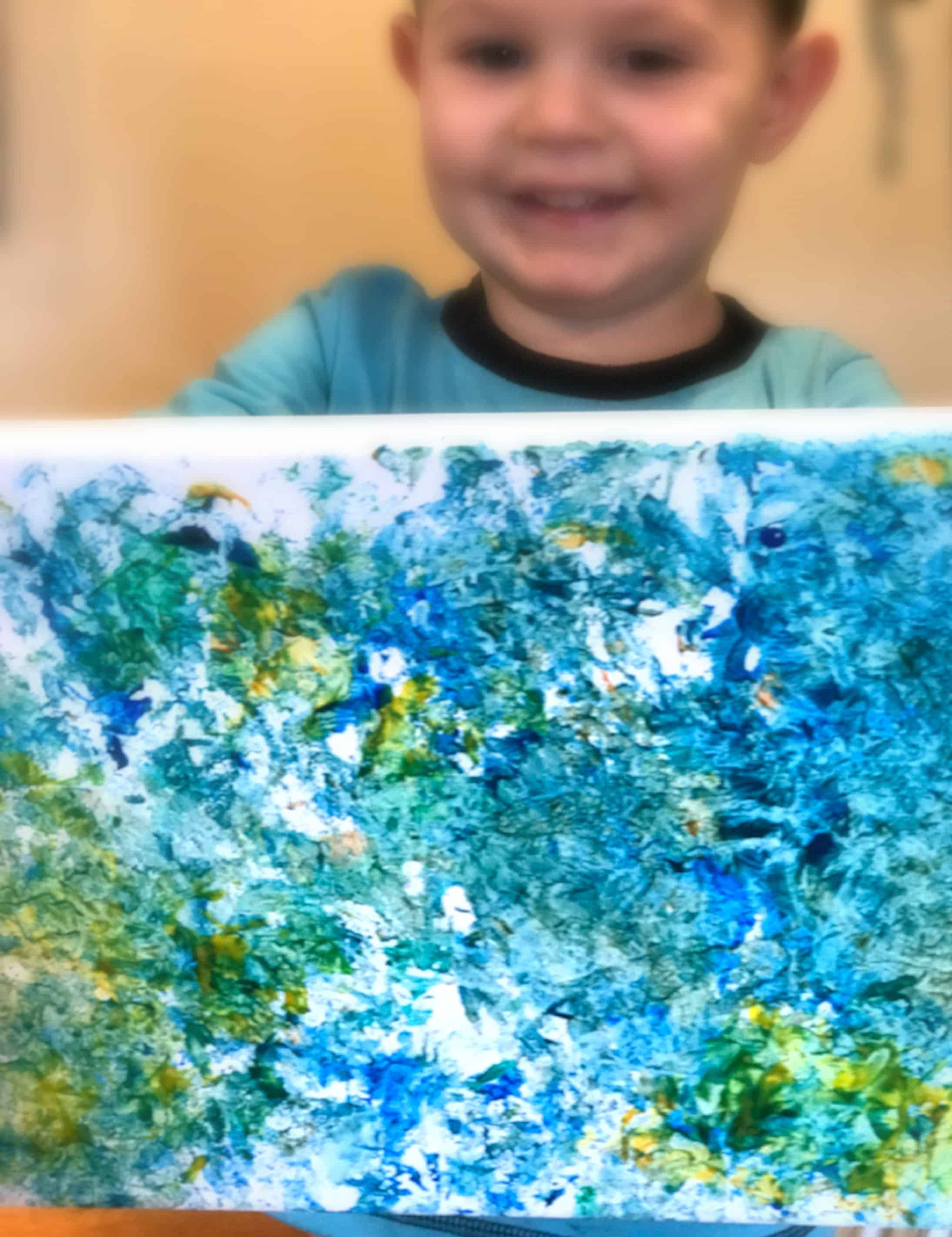 How fun to paint using leftover wrapping paper! Gift wrap is so beautiful and to just toss it after one use it a shame. Check out how we crumple up the gift wrap and stamp with it!