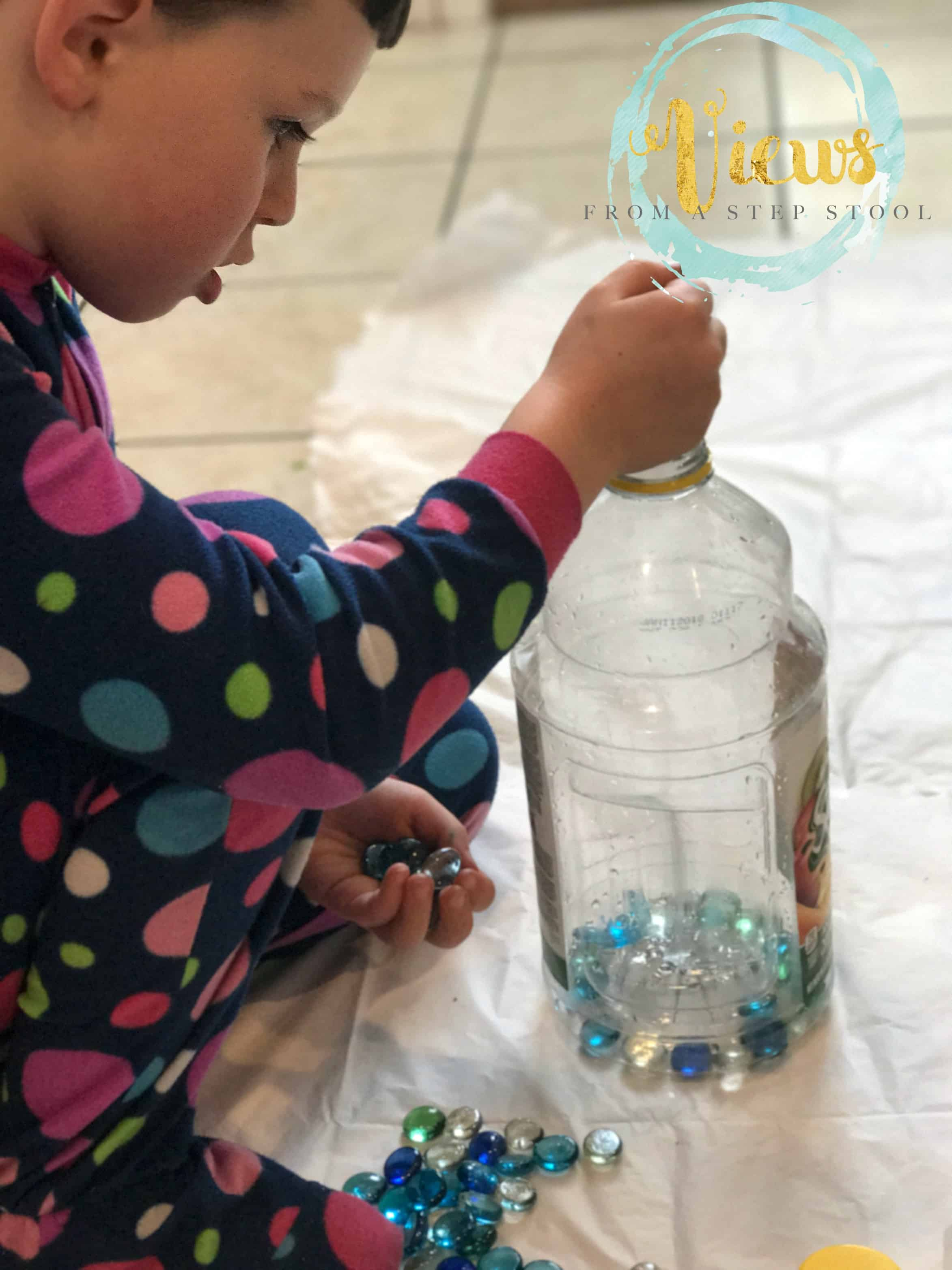 This sensory process art activity uses recycled materials and the exploration of weight to create art!