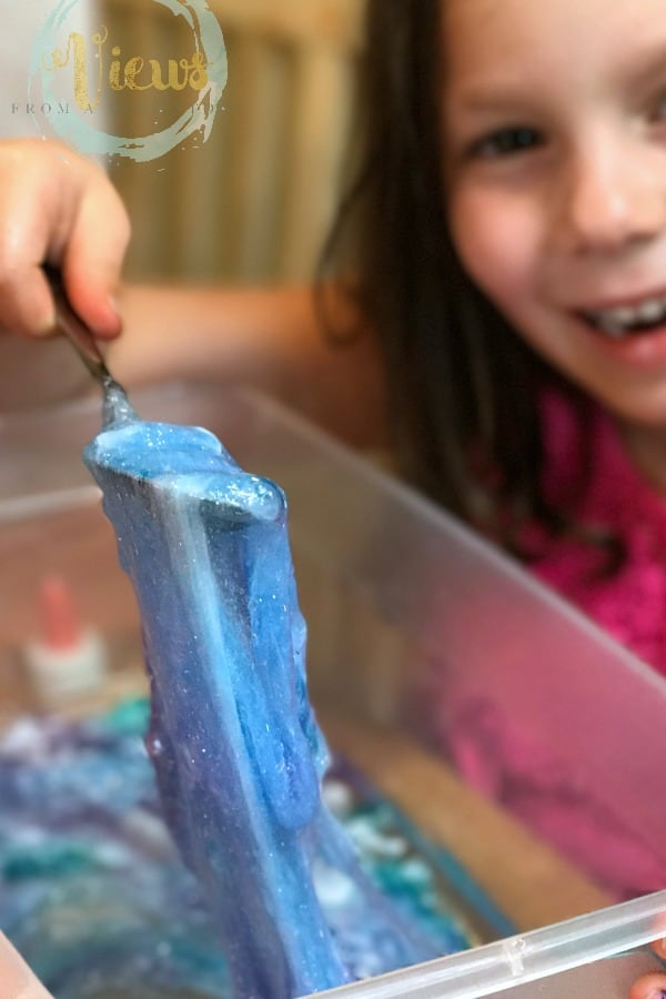 This Moana ocean slime has the perfect texture for sensory play and is made without borax, using contact solution instead with Moana toys and shells. Borax-free slime perfect for sensory play for kids.