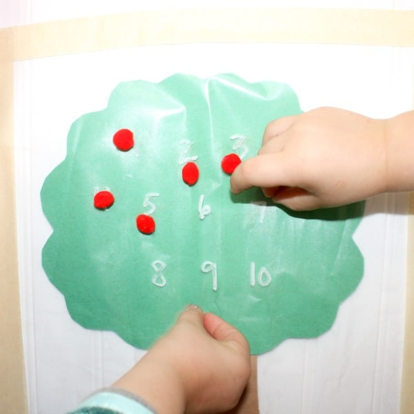 This sticky wall is perfect for the Fall as a fun apple-themed activity to do with kids. Pairs perfectly with the book, Ten Red Apples.