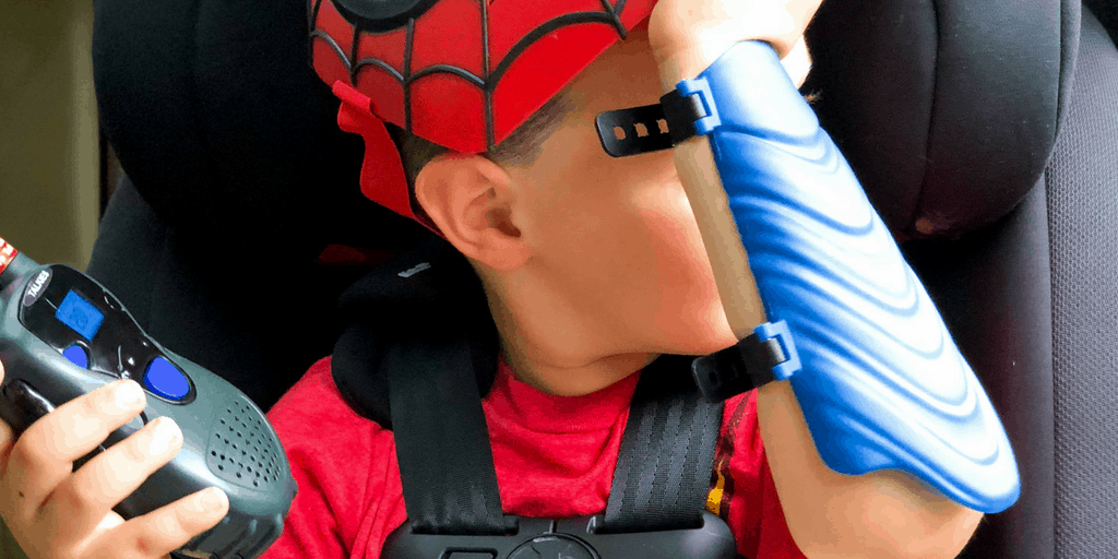 boy in car seat dressed up