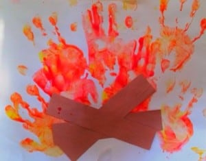 This is a really fun campfire handprint art activity for all ages! PLUS, check out a free printable template to make this even easier, AND how we make our homemade, edible finger paint!