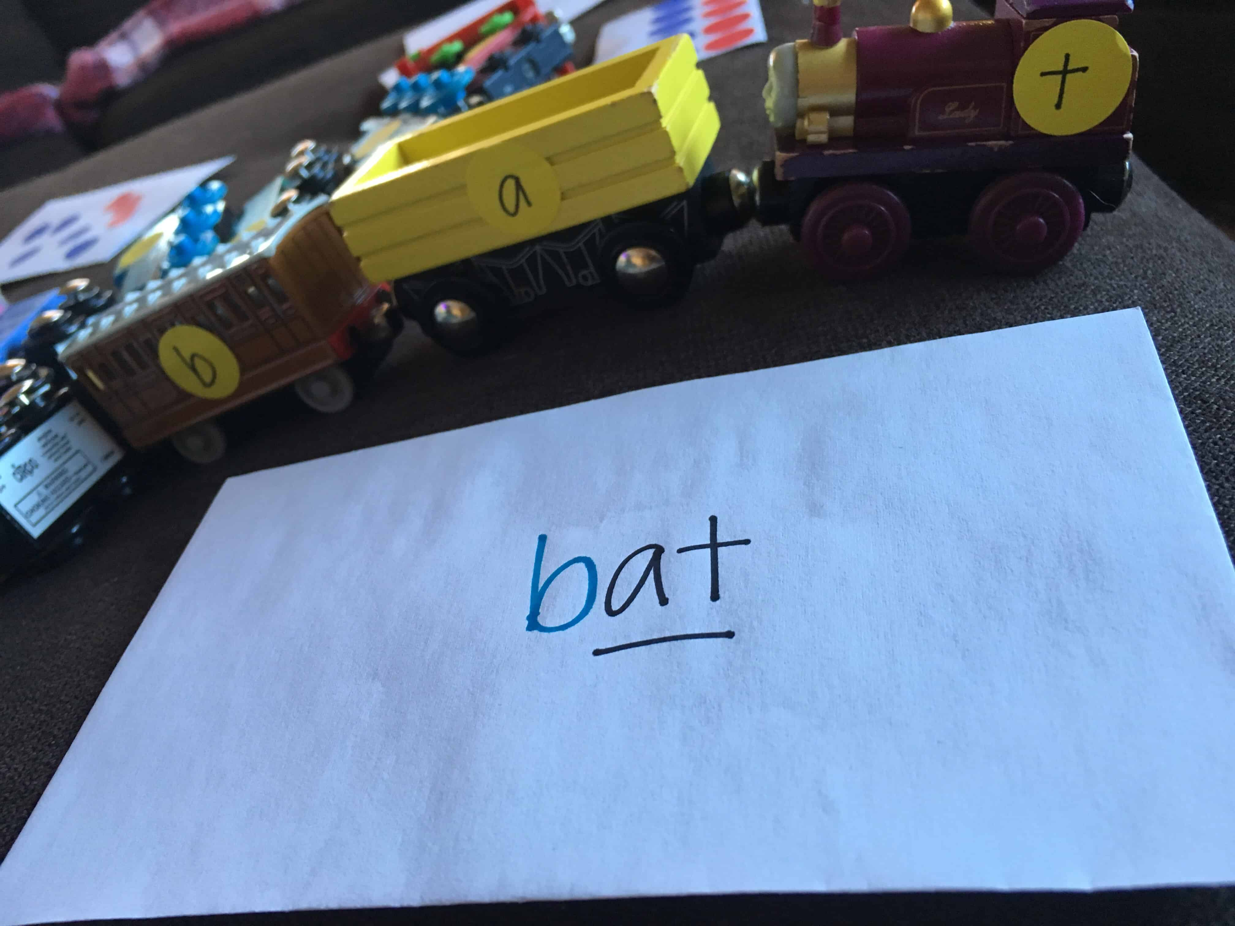 Learn to spell by making literacy fun through play! Use stickers on toy trains to create sight words.