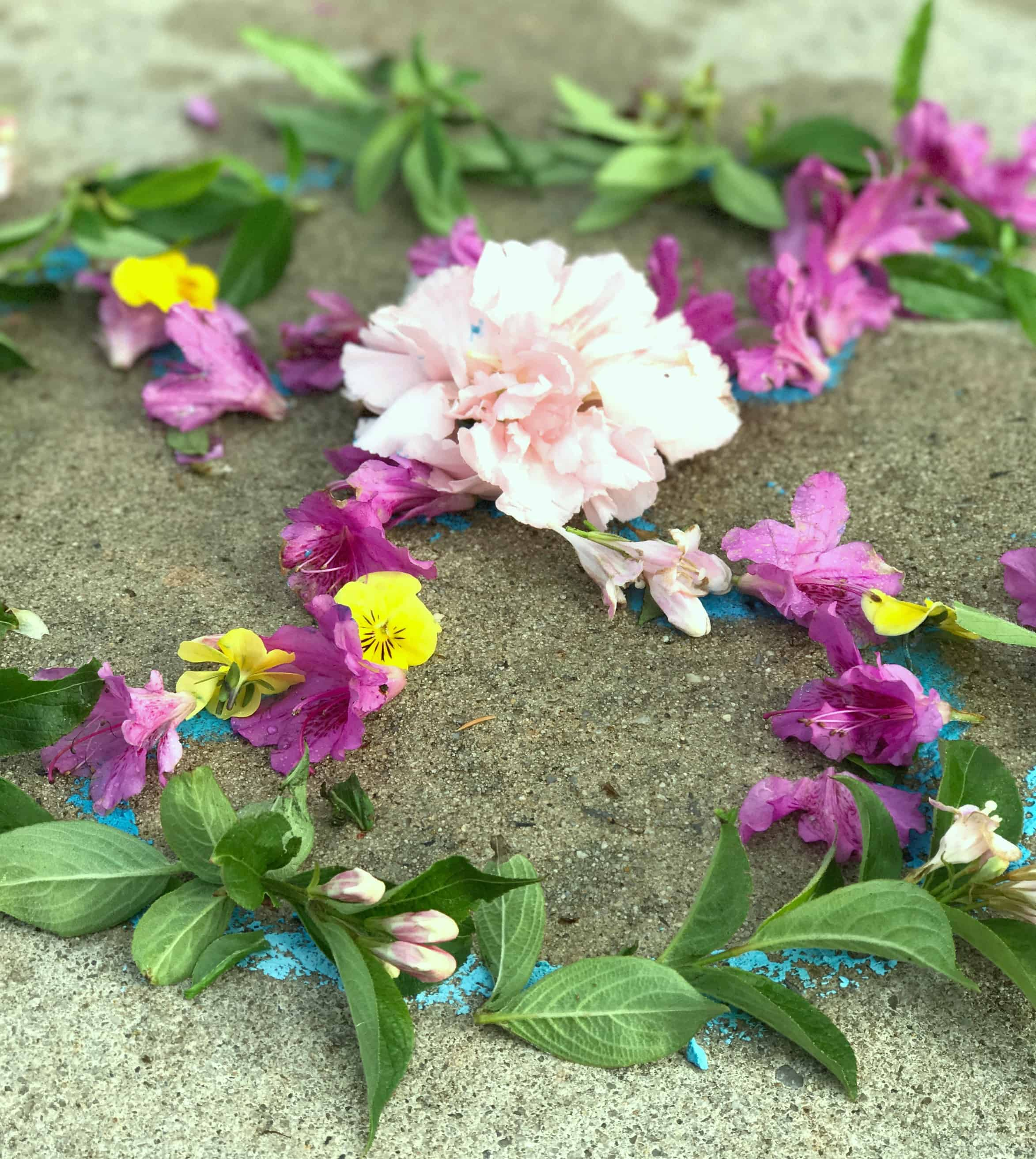 Making this flower mandala process art is a great way to get kids outdoors creating! They turned out so beautiful, and using a chalk template made these doable for even young children.