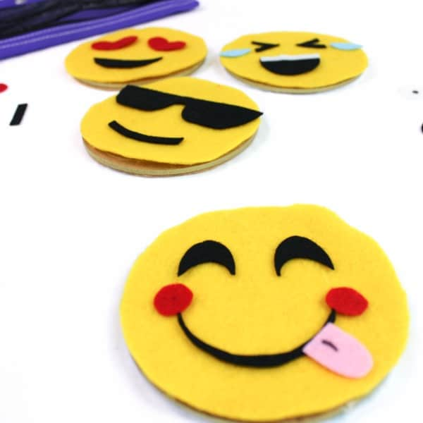 A felt emoji busy bag where both toddlers and big kids can create their own emojis over and over again!