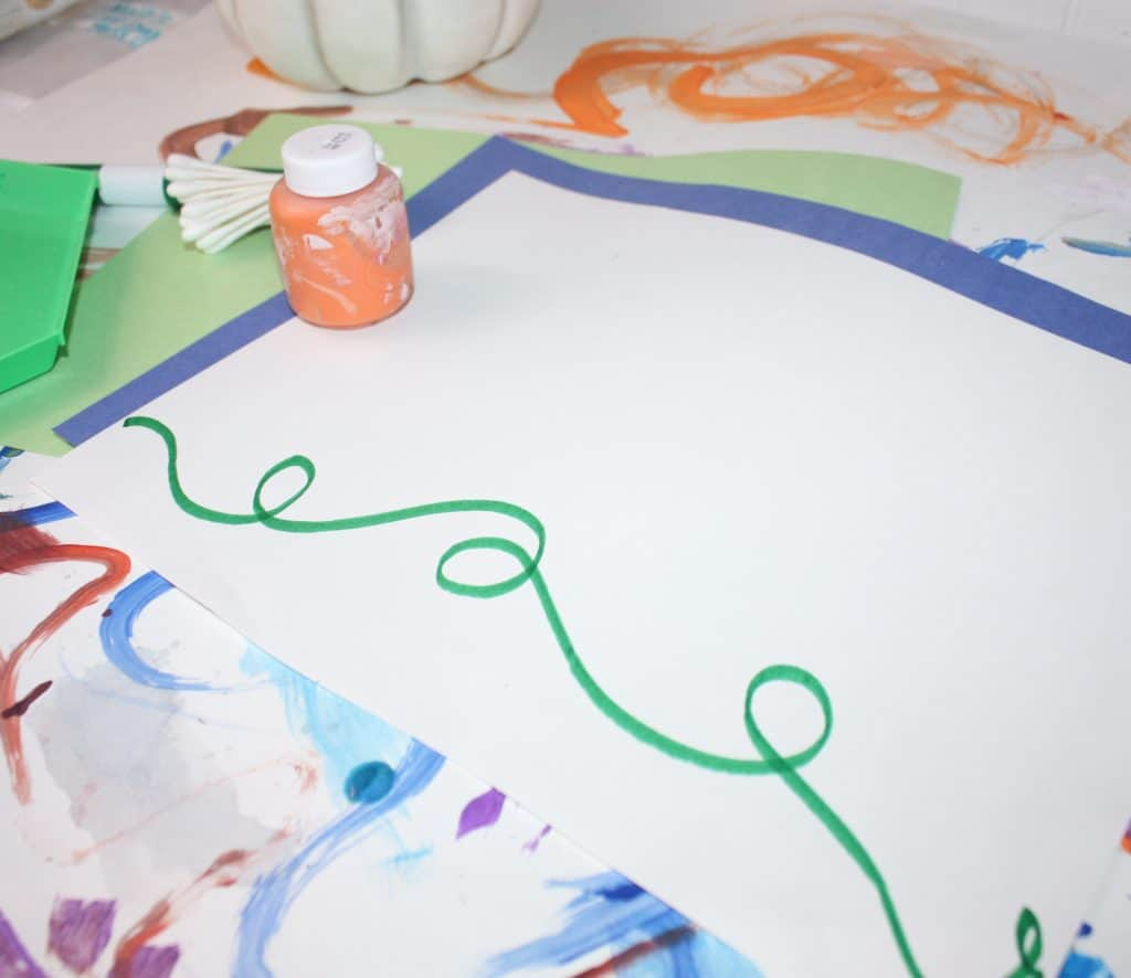 Paint with Q Tips! Perfect for toddlers and preschoolers, this Fall q tip painting creates an adorable little pumpkin patch!