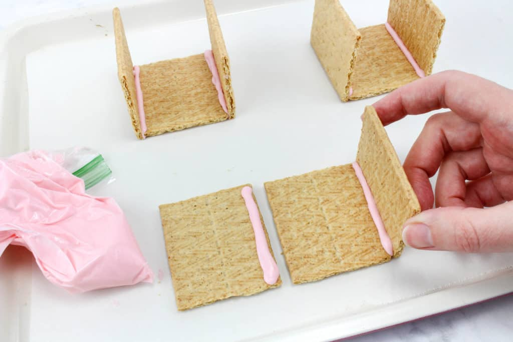 Can you build a Peeps house? This STEM challenge for big kids is perfect for Easter or Spring. Using graham crackers and frosting, will the house stand?