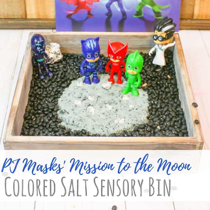This space sensory bin uses colored salt and beans to create a fun space scene for kids to play in. Play with the PJ Masks and their Mission to the Moon! #spacetheme #sensorybin #sensoryplay #preschool #toddlers #kidsactivities #preschoolfun