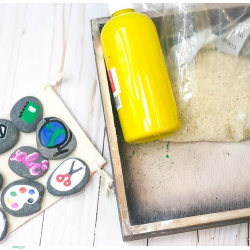 yellow paint and painted rocks