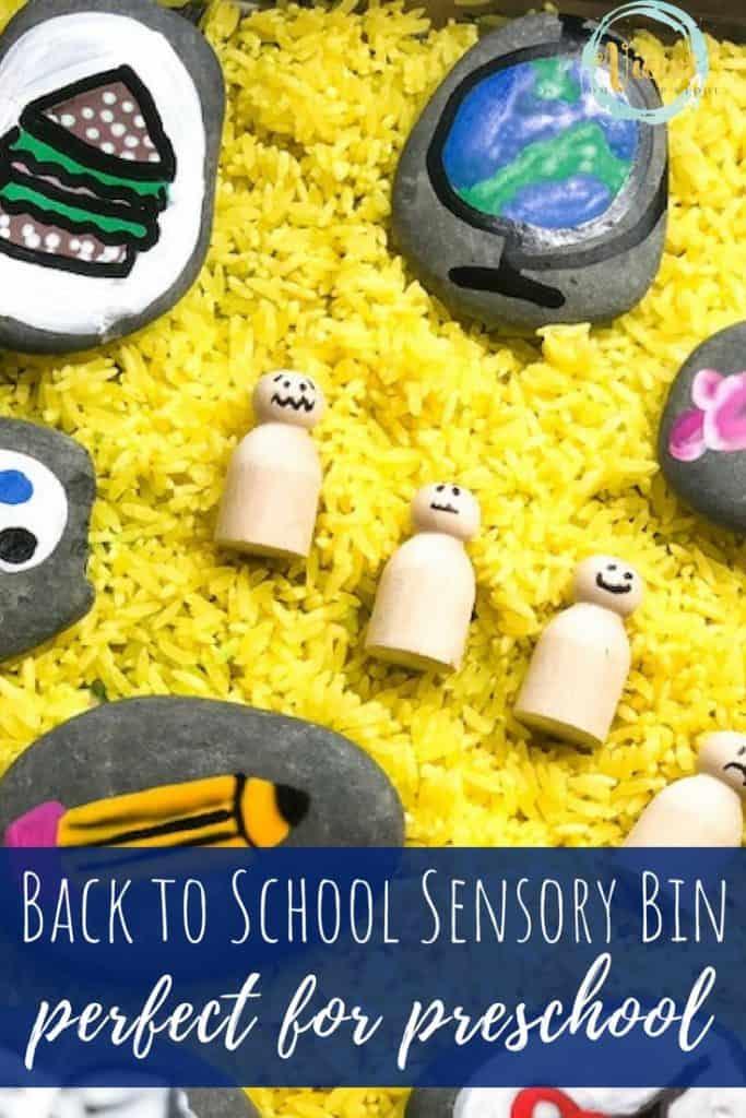 school sensory bin with emotion wooden dolls