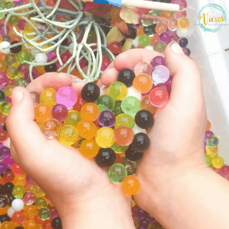 water beads in child's hands
