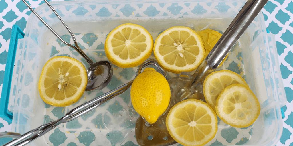sliced lemons and whole lemons in bin