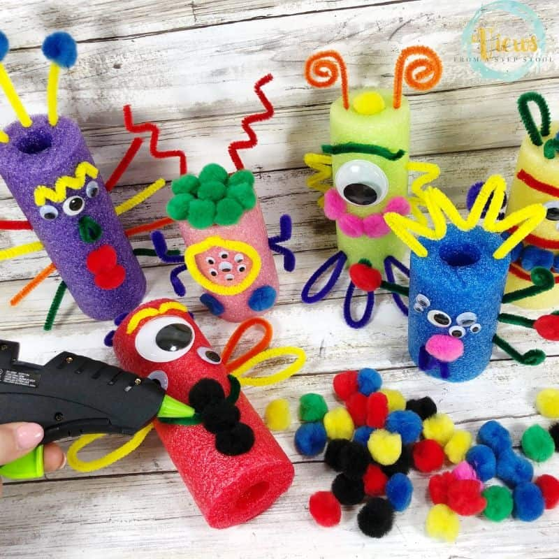 monster STEM challenge with pool noodles and pipe cleaners on wood background