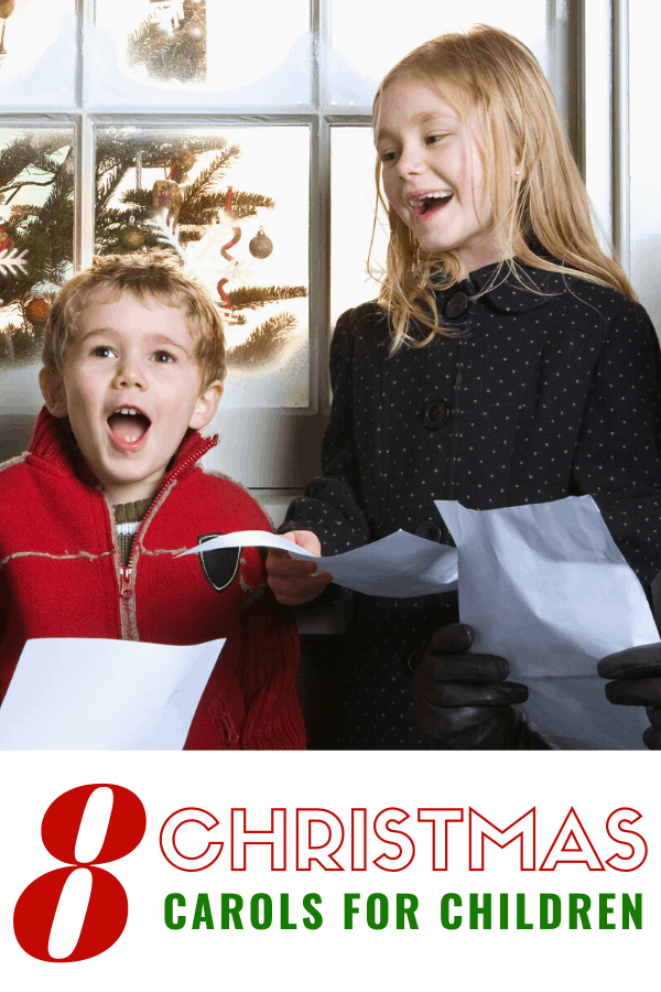 two kids singing christmas carols for kids