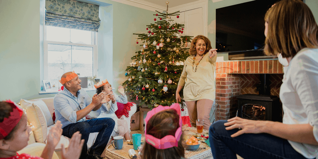 family playing Christmas charades game
